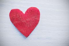 Retro stylized heart made of beet on grunge background. - stock photo