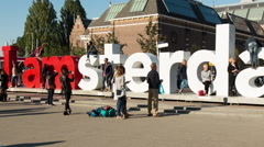 Time Lapse Pan - Amsterdam Sign & People - Rijksmuseum - Amsterdam Netherlands - stock footage