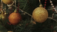 Christmas tree branch decorated with two balls Stock Footage