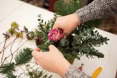 Creating a wonderful composition cotton, cones, fir, magical variety carnations - stock photo