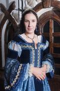 Portrait of elegant woman in medieval era dress - stock photo