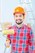 Handsome man doing renovation - stock photo