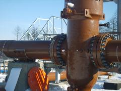 Latch on the pipeline with the electric drive - stock photo