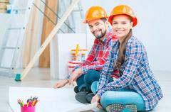 Pleasant couple drawing plan - stock photo