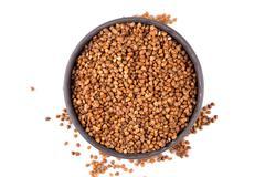 Buckwheat groats in a bowl - stock photo