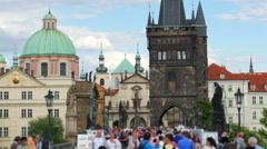 People walking crossing charles bridge, prague, czech republic, 4k Stock Footage