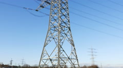 Electricity pylons, high voltage power line - stock footage