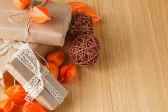 Paper wrapped gift box with fall theme - stock photo