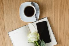 office table with notepad and coffee cup - stock photo