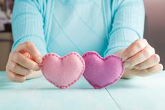love concept. Female holding a hearts in hands. - stock photo