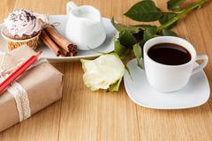 Coffee, white rose and gift Stock Photos
