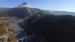 Sisteron citadel, the River Buech and road and rail bridges, French Alps, France Stock Footage