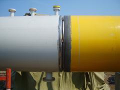 Welding seam on the pipeline - stock photo