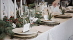 The waiter serves rustic wedding table Stock Footage
