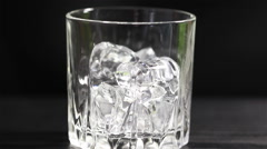 Cognac with ice 1 - stock footage