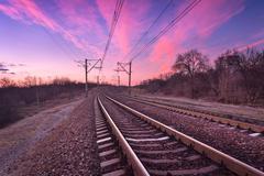 Train platform at sunset. Railroad. Railway station - stock photo