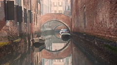 Suspended bridge over Venice canal on sunset Stock Footage