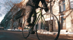 Young man riding fixed gear bike on the road of city centre,super slow motion Stock Footage