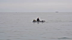 A fisherman in an inflatable boat - stock footage