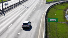 Vehicles move down to the right driving on the motorway for its lane Stock Footage