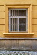 Window with wrought iron bars Stock Photos