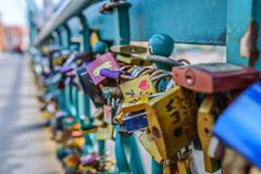 Locks on railing of bridge - stock photo
