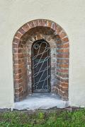 Window with wrought iron bars - stock photo
