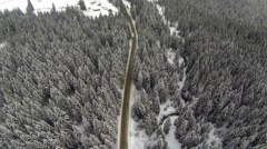 Aerial shot of snow-covered road in the countryside Carpathian Mountains Stock Footage