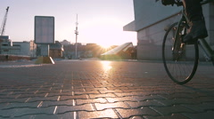 Guy riding fixed gear bike in marine station, slow motion - stock footage