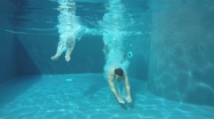 Couple diving and swimming underwater - stock footage