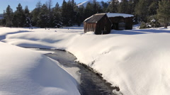 Old Cabins along a snowy creek - stock footage