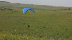 Paragliders in nature, close to the village Stock Footage