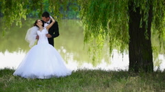 Happy newlyweds on nature Arkistovideo