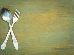 Fork and spoon on old wood - stock photo