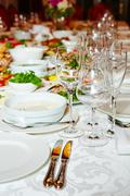 Table set for catered event dinner - stock photo