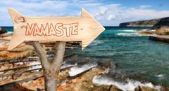wooden sign indicating to namaste - stock photo
