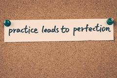 practice leads to perfection - stock photo
