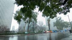 Homeless tents on Downtown Los Angeles street in rain 4K Stock Footage