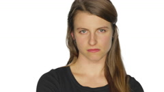 Angry young woman glares and shakes her head. Stock Footage