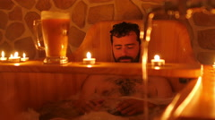 happy man in czech beer spa in prague - stock footage