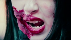 Close-up shot of terrible aggressive monster face with bloody wound near mouth - stock footage