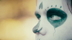 Closeup of male face with scary zombie makeup, actor posing in front of camera Stock Footage