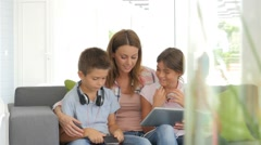 Mother with kids playing with digital tablet Stock Footage