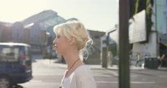 Beautiful blonde walking though city - stock footage