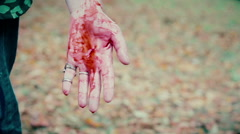 Hand of furious gangster bleeding, murderer enjoying view of victim's blood Stock Footage