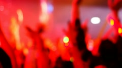 Blurred focused concert crowd in hall Stock Footage