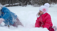 Children playing in the snow - stock footage