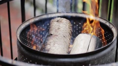 Fire Drum with Burning Logs and Bright Flames and Smoke Stock Footage