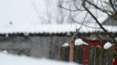 Falling snow on the background of the fence Stock Footage