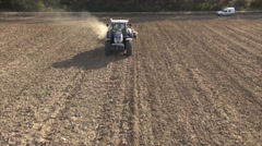 Tractor working in a field in autumn, Trets, Var, Provence, France by drone Stock Footage